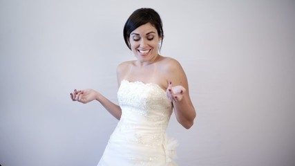 Beautiful Bride to be Smiling & Dancing on her Wedding Dress