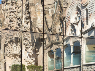 Relefection of Sagrada Familia in modern glass window and Sky