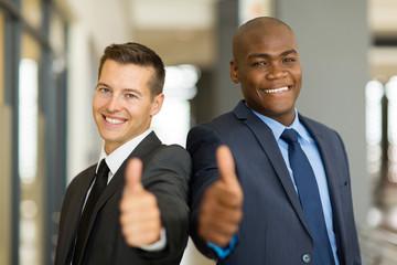 multiracial business men thumbs up