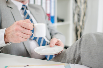 Relaxed businessman with a cup of coffee