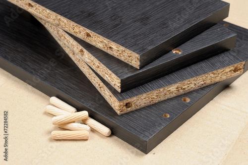 closeup black particleboard and bolt - 72284582