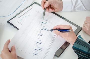 Teamwork on a stock market chart