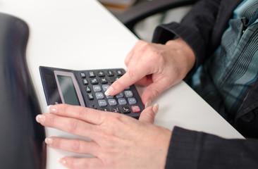 Businesswoman using a calculator