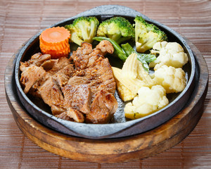 Juicy grilled pork chop (neck cut) with vegetables