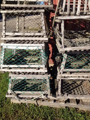 old wood lobster traps in a pile