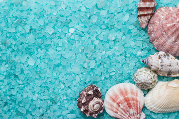 blue bath salt and seashells