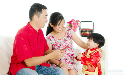 Chinese boy wishing his parent a happy chinese new year