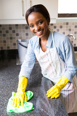 african housewife cleaning the kitchen
