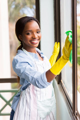 african girl cleaning window glass