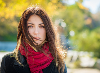 Beautiful young woman in a jacket with scarf. Autumn portrait.