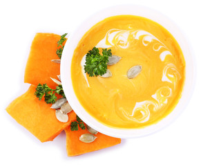 Pumpkin soup and fresh pumpkin slices isolated on white