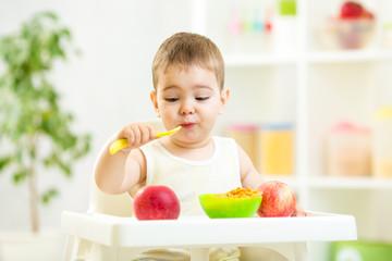 funny kid eating healthy food indoor