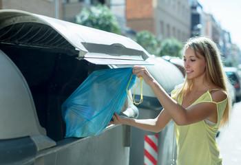 woman  near garbage bin