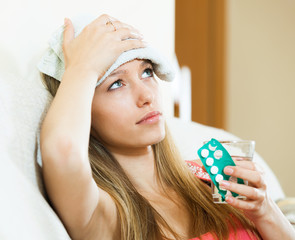 Woman with headache take medicine
