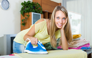 Girl ironing at home