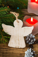 Christmas tree branches with angel on a wooden board
