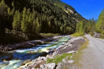 Rapid mountain stream near the road
