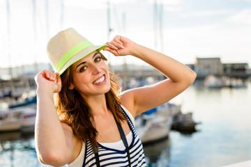 Joyful tourist on summer travel by the harbor