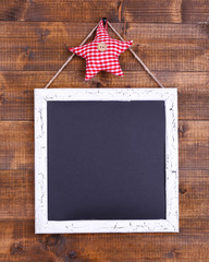 Square chalkboard on wooden background