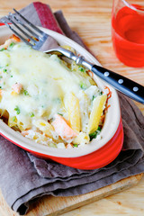 pasta with salmon baked under cheese