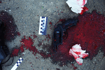 Gun and blood at crime scene