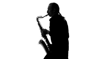 Close up of silhouette of saxophonist playing his musical