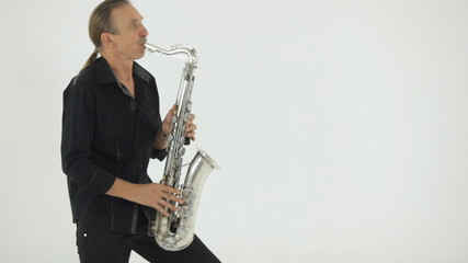 Saxophonist in black clothes brilliantly plays his musical