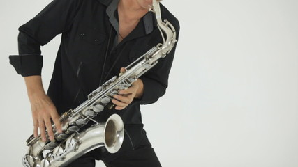 Close up of a saxophone on which musician  plays