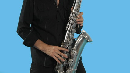 Talented saxophonist plays on his musical instrument and moves