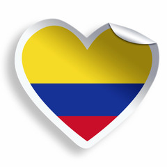 Heart sticker with flag of Colombia isolated on white