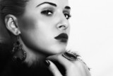 beautiful young woman.monochrome portrait.fur.Jewelry