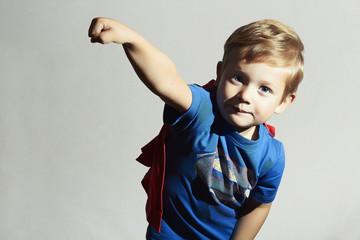 Child in superhero suit. superman.little boy Halloween