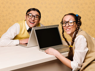 Young nerds sitting at the desk