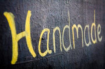 Handmade word written on blackboard
