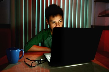 Young Teen in front of a laptop computer