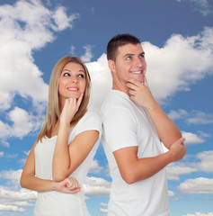 Pensive couple with a blue sky