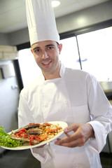 Portrait of young chef in restaurant