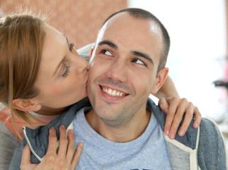 Girl giving kiss to boyfriend