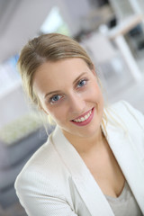 Portrait of young woman in office