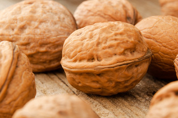 Close up of walnuts over wooden table