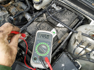 Mechanic measures charge voltage