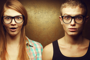 Eyewear concept. Gorgeous red-haired twins in glasses