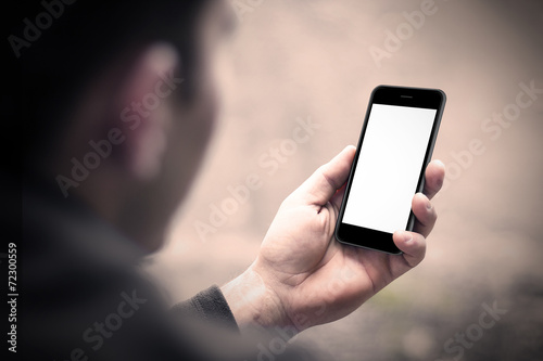 Man using mobile smartphone. Shot with third person view. - 72300559