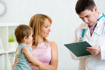 kid and his mother consulting with the doctor in hospital