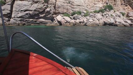 Girl jump in sea