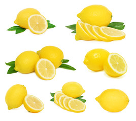 Set whole and sliced lemons with green leaves (isolated)