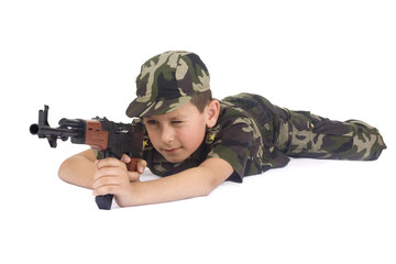 Young boy hold gun isolated on white background