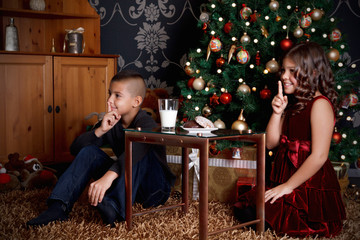 Cute little kids waiting for Santa Claus
