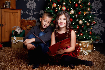 Cute children singing a song at Christmas Eve