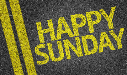 Happy Sunday written on the road